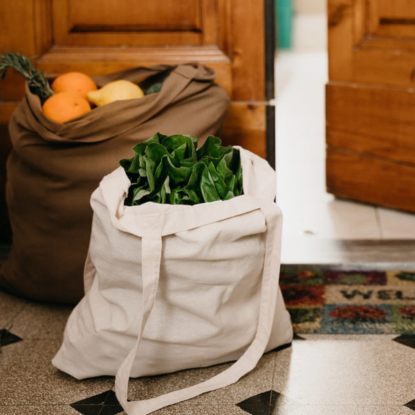 Bag of produce in doorway ready to give to those in need