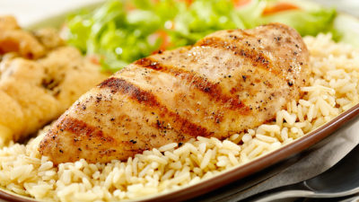Close up of Greek chicken and rice with veggies