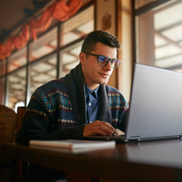 Man working from home in fashionable sweater