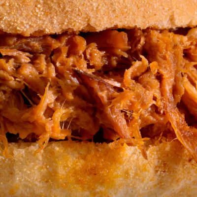 Close up image of a pulled pork sandwich