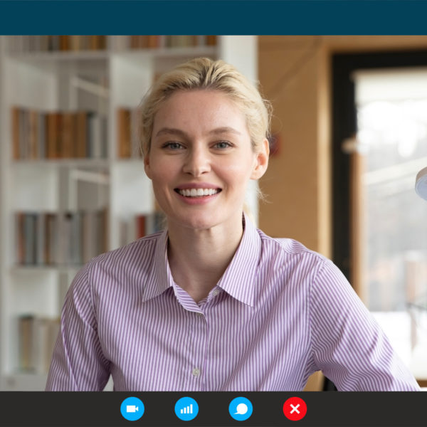 Woman in button up for zoom meeting for work from home
